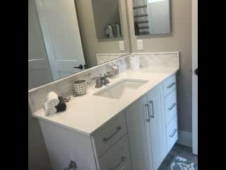 Your private, attached bathroom with tub and shower.