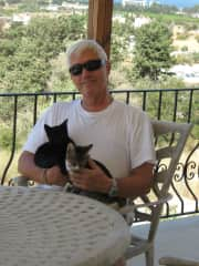 My husband with two of our cats, Sooty and Socks