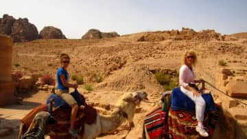 My mom and me riding camels on a trip to Israel and Jordan!
