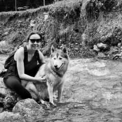 Biviana with her beloved dog Maya hiking