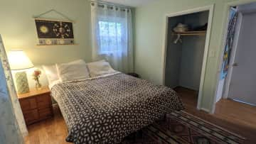 The guest bedroom where the sitter will stay. Queen size bed with extra sheets in the closet. It has its own 1/2 bathroom attached for convenience.