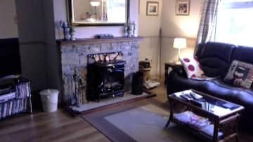 Sitting room with wood burner stove.