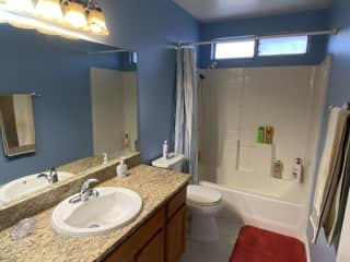 Your bathroom with empty cabinets.