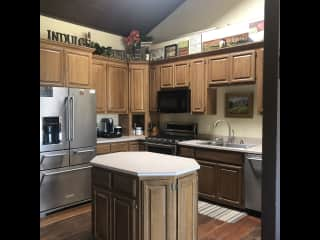 Small family kitchen with dishwasher and microwave