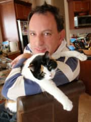 Babak with our cat, Booboo, who who is now in kitty heaven.