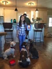 Alyssa giving the pups some treats for Coco's birthday