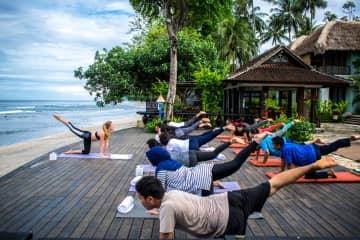 giving a yoga session in Bali