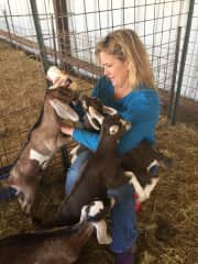 Feeding baby goats at a goat dairy farm my daughter worked at while completing her degree in Animal Science.