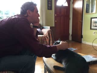 Phil with a male cat that we cared for in Maryland one summer.