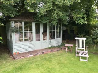 Our summer house at the bottom of our secret garden