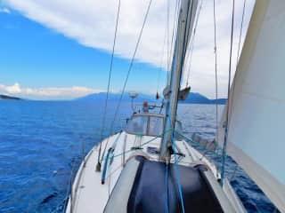 Danka at the helm - sailing in the Ionian Sea, Greece