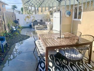 Backyard with a BBQ, herb garden, and outdoor games!