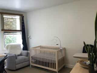 Second bedroom, set up for our baby, but you could work in here and the rocking recliner is a dream.
