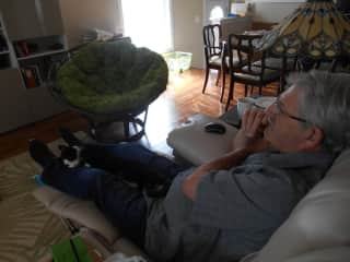 My husband, Steve, with our cat in his favorite napping spot