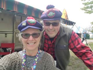Here is photo of my husband and I with our vintage camper at a rally dressed in our period look!