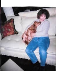 Linda with neighbor's dog, Emma in Louisiana.  It was love at first sight.