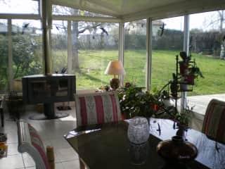 Verandah/dining room with log burner
