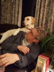 Neighbor's dog, Lilly, relaxing on Tom