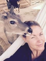 Bonding with Tucker the deer.