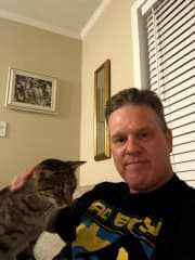 """My cat """"Alex."""" Named after Alex Gustaffeson, whose shirt I'm wearing."""