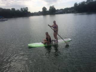 Cindy paddleboarding last week with daughter and Mickey the neighbor's poodle.