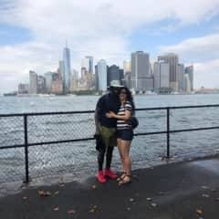Remi and Catarina on Governor's Island taking in the Manhattan skyline.