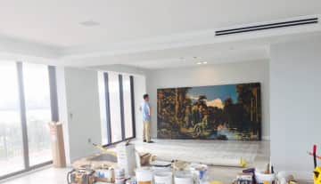 Installing a large painting of mine in a homeowner new penthouse in USA coordinating with the construction and interior design crew.
