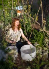 Me in the garden playing a few of my crystal singing bowls - I love nature and sound therapy!