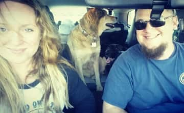 My husband and I on a road trip with our pack!