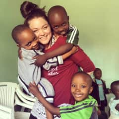 Nancy with three of our kiddos at Tupendane Orphanage Center