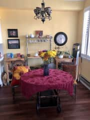 Open dining table opposite the living room and next to kitchen