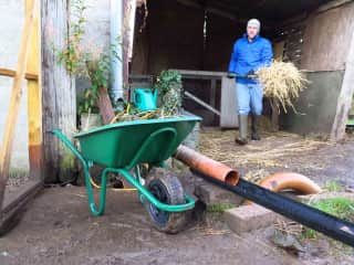 Peter cleans the duck pen in our Nairn house-sit.
