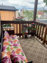 Chill on the back patio that overlooks the communal building yard - gas grill included