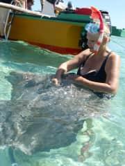 Jacquie making friends in Bora Bora with a stingray