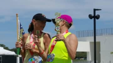 First and last time I beat Mary in the 5K SUP race. I am on left.