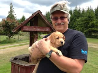 Mark with service dog puppy