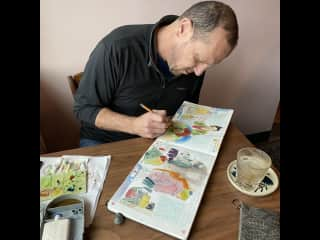 Here is Chris at work. Chris hopes to use his sabbatical year to develop his skills and draw the animals we encounter.