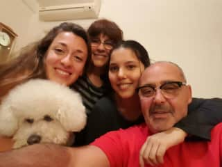 This is me holding Roberto in my arms and my family (cousin and uncles). Roberto is his lovely dog.