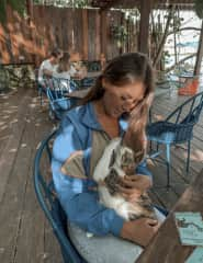 cuddling with a cat in Bacalar, Mexiko