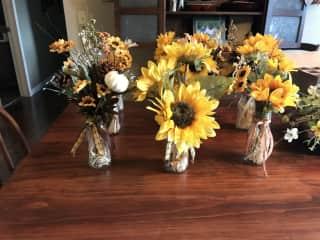 I made these little arrangements. I enjoy arranging flowers & making grave saddles