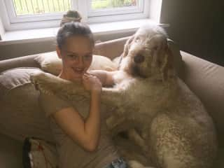 Teddy with our daughter - having a cuddle