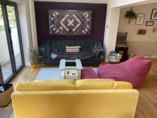 Lounge area with giant TV in kitchen/diner room