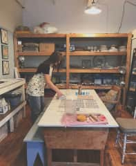 In my ceramic studio. My jewelry business started as a ceramic jewelry line and has since evolved to primarily gold filled pieces.