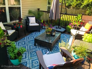 My deck in early spring-I like to make it my calm oasis. I love gardening so there will be tons of flowers, plants and veggies in bloom all summer long into the fall/winter until I absolutely have to put them inside or cut them back!
