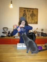 Edwina feeding Katy and Jason's cats while housesitting in London