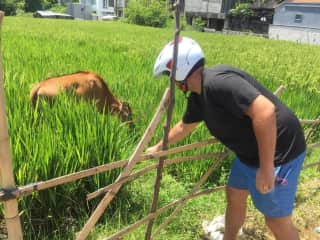 Rob making friends with the neighbors in Bali