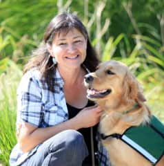 Sue and Narnia, a service dog in training