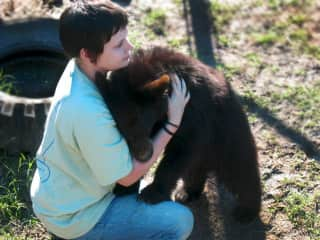 Working at the C.A.R.E. Foundation with Lola (Baby Black Bear)