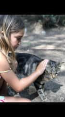 Aolani with Chatter, a talkative stray cat we cared for for two months while in Italy.