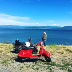 Todd and Dorcie with their Vespas on Bellingham, Bay
